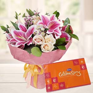Lilies With Celebration Pack: Gifts For Husband Collectorate,  Indore